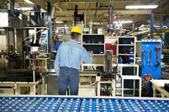 Man Working in Industrial Manufacturing Factory Stock Photo