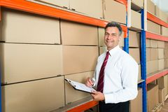 Manager With Clipboard In Distribution Warehouse Stock Images