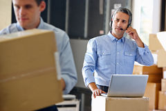 Manager Using Headset In Distribution Warehouse Royalty Free Stock Image