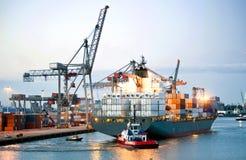 Maneuvering container ship Royalty Free Stock Photos