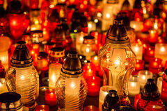 Many burning candles in the cemetery at night on the occasion memory of the deceased.Souls. Royalty Free Stock Images