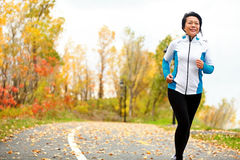 Mature Asian woman running active in her 50s Royalty Free Stock Photos