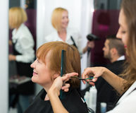 Mature woman in the barbershop Royalty Free Stock Images