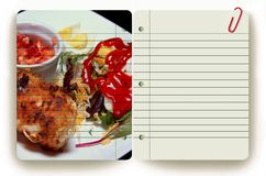 Meal and notepad Stock Images