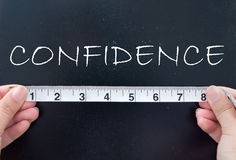 Measuring confidence Royalty Free Stock Photo
