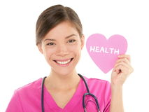 Medical nurse doctor showing HEALTH sign on heart Stock Photography