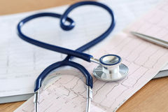 Medical stethoscope twisted in heart shape Royalty Free Stock Images