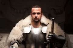 Medieval warrior in armor and fur mantle Royalty Free Stock Photography