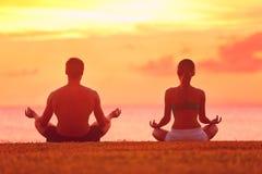 Meditation yoga couple meditating at beach sunset Royalty Free Stock Photo