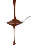 Melted chocolate poured into a spoon. Royalty Free Stock Photos