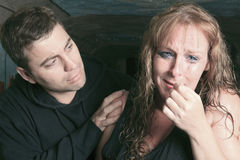 Men consoling woman and trying to calm down Royalty Free Stock Photography