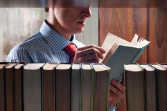 Men reading a book Royalty Free Stock Image