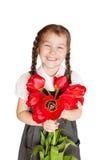 Menina da escola de Litlle com o ramalhete das tulipas Foto de Stock