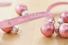Merry Christmas written on pink  ribbon Stock Images