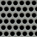 Metal surface with holes. Royalty Free Stock Photos