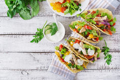 Mexican tacos with chicken, black beans and fresh vegetables and tartar sauce Stock Photo