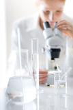 Microscope laboratory - woman medical research Royalty Free Stock Photos