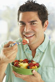 Mid Adult Man Holding A Bowl Of Fresh Fruit Salad Royalty Free Stock Photos
