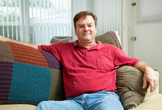 Mid Adult Man Relaxing at Home Stock Image