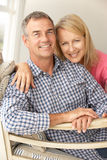 Mid age couple at home Stock Photography