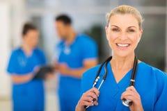 Mid age female nurse Stock Photography