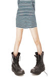 Military boots, striped singlet on woman feet Stock Photography