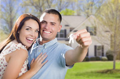 Military Couple with House Keys In Front of New Home Royalty Free Stock Image