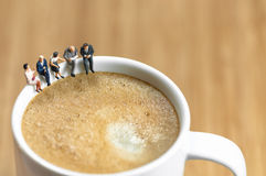 Miniature business team having a coffee break Stock Images