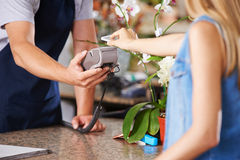 Mobile Payment at checkout in retail store Royalty Free Stock Image