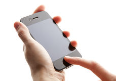 Mobile phone in the hands Stock Images
