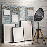Mock up posters with industrial lamp in loft interior background Stock Photos