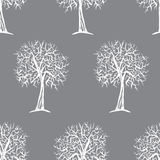 Modèle sans couture de vecteur avec des silhouettes d'arbres Images libres de droits