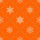Modèle sans couture des flocons de neige, blanc sur l'orange Images stock