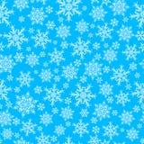 Modèle sans couture des flocons de neige, blanc sur le bleu Photographie stock libre de droits