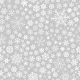 Modèle sans couture des flocons de neige, blanc sur le gris Photo stock