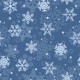 Modèle sans couture des flocons de neige, bleu-clair sur le bleu Image stock