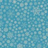 Modèle sans couture des flocons de neige, gris sur bleu-clair Photo stock