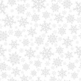 Modèle sans couture des flocons de neige, gris sur le blanc Photos libres de droits