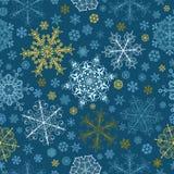 Modèle sans couture des flocons de neige, multicolore sur le bleu Image libre de droits