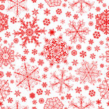 Modèle sans couture des flocons de neige, rouge sur le blanc Photos stock