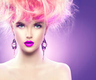 Model girl with updo hairstyle and stylish makeup Royalty Free Stock Photo