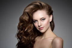 Model with long hair. Waves Curls Hairstyle. Hair Salon. Updo. F Royalty Free Stock Image