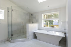 Modern bathroom with shower and bathtub Stock Photos