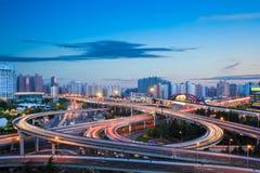 Modern city interchange overpass in nightfall Royalty Free Stock Photography