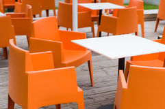 Modern furniture outdoor cafe terrace with orange chairs Stock Images
