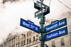 Modern urban street sign and vapor steam in New York City Royalty Free Stock Image