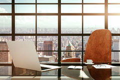 Modern workplace with a laptop and office accessories at sunrise Royalty Free Stock Photos