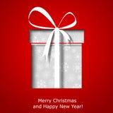 Modern Xmas greeting card with Christmas gift box Royalty Free Stock Photos