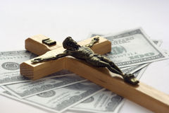 Money and religion Royalty Free Stock Images
