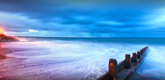 Moonlight lit beach landscape Royalty Free Stock Image